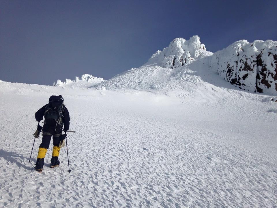 Jay crosses the plateau Mt. Shasta's summit in sight