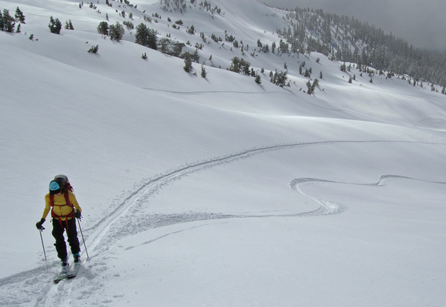 Jen Carr skinning up the Gulch, good turns await!