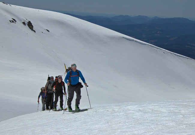 Rich Meyer skis up the middle moraines Mt. Shasta